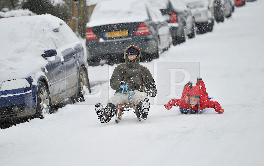 © Licensed to London News Pictures. 20 January 2013. Chipping Norton, Oxfordshire. Probably the best Street in England for sledging? Residents of The Leys in Chipping Norton have made a super sledging run in the road. The local children even prevented council workers from salting the road by sitting down across the road to block the gritters. Everyone who live in the Leys seems to love the sledging run and have even joked that they want to apply for a ski lift to be installed for future years fun.. Photo credit : MarkHemsworth/LNP