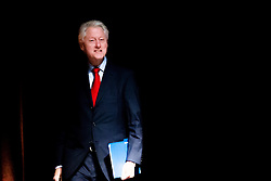 © Licensed to London News Pictures. 23/07/2014. Former US President Bill Clinton walks in to address the crowd during a session of the 20th International AIDS conference held in Melbourne Australia. Photo credit : Asanka Brendon Ratnayake/LNP