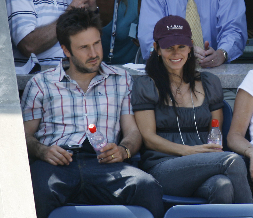 US actors David Arquette and Courteney Cox-Arquette the doubles match between Lisa Raymond/Samantha Stosur and Martina Navratilova/Nadia Petrova  on the eleventh day of the 2006 US Open tennis tournament in Flushing Meadows, New York Thursday 07 September 2006.