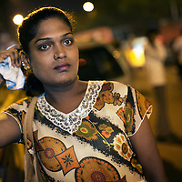 Kavia, an Aravani looks for sex works on the streets of  Chennai...India's transexual community has a recorded history of more than four thousand years. Many consider the The Third Sex, also known as Aravanis, to posses special powers allowing them to determine the fate of others. As such, they are not only revered but despised and feared too. Resigned to the fringes of society, segregated and excluded from most occupations, many Aravanis are forced to turn to begging and sex work in order to earn a living. ..The annual transgender festival in the village of Koovagam, near Vilappuram, offers an escape from this often desolate existence. For some, the week-long partying and frenetic sex trade that culminates in the Koovagam festival is about fulfilling lustful desires. For others, the gathering provides a chance for transgenders to bond, share experiences, join the wider homosexual gay-community and coordinate their campaign for recognition and tackle the challenge of HIV/AIDS. ..It is the Indian state of Tamil Nadu that the eighty-thousand-strong Aravani community has made advances in their fight for rights. In 2009, the Tamil Nadu state government began providing sex-change surgery free of cost. The state has also offers special third-gender ration cards, passports and reserved seats in colleges. And 2008 the launch of Ippudikku Rose, a Tamil talk-show fronted by India's first transgender TV-host and the release of a mainstream Tamil film staring an Aravani in the lead-role. ..These advances clearly signal a victory for south India's transgenders, but they have also exposed deep divisions within the community. There is a very real gulf that separates the majority poor from their potentially influential but often reticent, upper-class sisters. ..Photo: Tom Pietrasik.Chennai, Tamil Nadu. India.May 2009