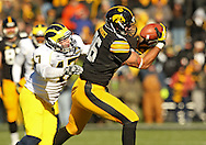 November 23 2013: Iowa Hawkeyes tight end C.J. Fiedorowicz (86) pulls in a pass as Michigan Wolverines linebacker Jake Ryan (47) defends during the first quarter of the NCAA football game between the Michigan Wolverines and the Iowa Hawkeyes at Kinnick Stadium in Iowa City, Iowa on November 23, 2013. Iowa defeated Michigan 24-21.