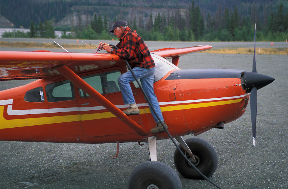 John Claus fueling Airplane, Ultima Thule Lodge, Wrangell St. Elias National Park, Alaska, USA