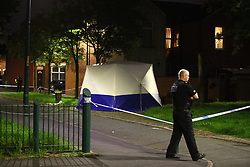 © Licensed to London News Pictures. 26/07/2020. Manchester, UK. A second forensic tent erected on Roseberry Street, approximately half a mile from the scene on Henbury Street. A 17 year old boy was stabbed to death and three others stabbed causing injuries in Moss Side this evening. Photo credit: Joel Goodman/LNP