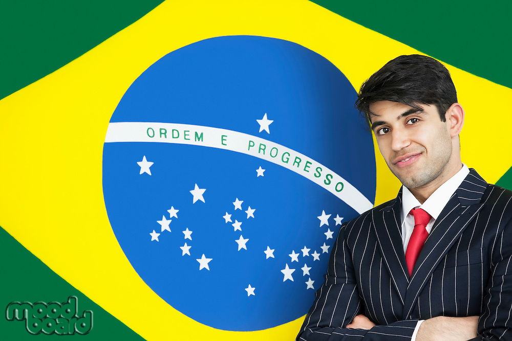 Portrait of a confident Indian businessman against Brazilian flag