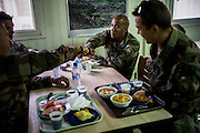 16th BC French unit soldiers have breakfast on September 25, 2012  in Warehouse base in Kabul. The French unit from Bitche (Moselle) will spend a week disassembling weapons, cleanning tanks and preparing their departure for France. AFP PHOTO / JEFF PACHOUD