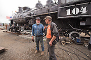 Dick Jamesguard, volunteer at the Oregon Coast Historical Railway museums, discussing the oil-burning engine steam locomotive No. 104 used to haul log trains.