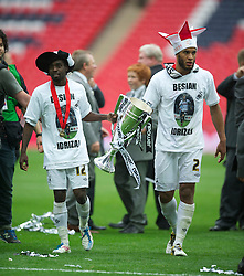 LONDON, ENGLAND - Saturday, May 30, 2011: Swansea City's Nathan Dyer and Ashley Williams celebrate with the trophy after their side beat Reading 4-2 after the Football League Championship Play-Off Final match at Wembley Stadium. (Photo by David Rawcliffe/Propaganda)