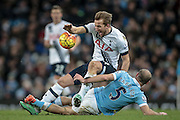 Harry Kane (Tottenham Hotspur) fouled by Pablo Zabaleta (Manchester City) during the Barclays Premier League match between Manchester City and Tottenham Hotspur at the Etihad Stadium, Manchester, England on 14 February 2016. Photo by Mark P Doherty.