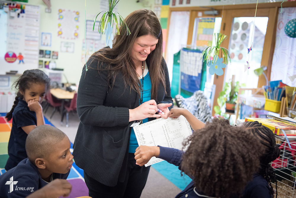 Kindergarten teacher Lindsay Beckstrom works with students in her class at the Renaissance School, part of Lutheran Urban Mission Initiative, Inc., on Wednesday, May 20, 2015, in Mt. Pleasant, Wis. LCMS Communications/Erik M. Lunsford