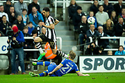 Leeds United defender Charlie Taylor (#21) slides in to win the ball from Newcastle United forward Ayoze Perez (#17) during the EFL Sky Bet Championship match between Newcastle United and Leeds United at St. James's Park, Newcastle, England on 14 April 2017. Photo by Craig Doyle.
