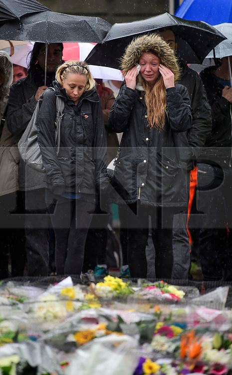 © Licensed to London News Pictures. 06/06/2017. London, UK.  Nicola Smith (right) the ex-girlfriend of attack victim James McMullan, is comforted by her sister during a minutes silence at London Bridge in central London for those who lost their life in a terrorist attack on Saturday evening. Three men attacked members of the public  after a white van rammed pedestrians on London Bridge.   Ten people including the three suspected attackers were killed and 48 injured in the attack. Photo credit: Ben Cawthra/LNP