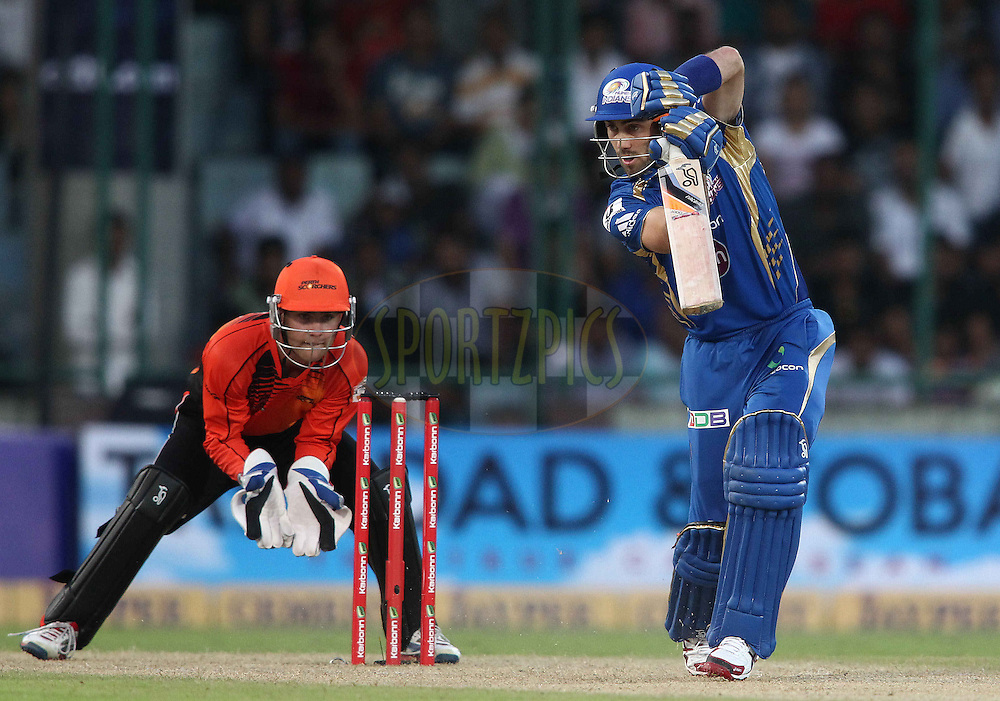 Glen Maxwell of Mumbai Indians drives a delivery during match 19 of the Karbonn Smart Champions League T20 between the Perth Scorchers and the Mumbai Indians held at the Feroz Shah Kotla Stadium, Delhi on the 2nd October 2013<br /> <br /> <br /> Photo by Shaun Roy-CLT20-SPORTZPICS <br /> <br /> Use of this image is subject to the terms and conditions as outlined by the CLT20. These terms can be found by following this link:<br /> <br /> http://sportzpics.photoshelter.com/image/I0000NmDchxxGVv4