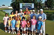 Tony Thomas son of Danny Thomas John Moses the CEO of St. Jude, Allen Stanford the CEO of Stanford, winner Justin Leonard with some of the kids of St. Jude.