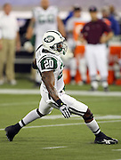 New York Jets running back Thomas Jones (20) makes a cut as he runs the ball for a fourth quarter first down during the NFL football game against the Buffalo Bills, December 3, 2009 in Toronto, Canada. The Jets won the game 19-13. ©Paul Anthony Spinelli