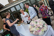 Chairman, Derek Wyatt, throws a drinks party to thank supporters and staff of the Trinity Hospice, Clapham, London, UK, 02 July 2014. Guy Bell, 07771 786236, guy@gbphotos.com
