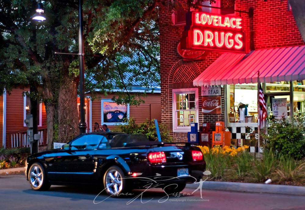 A Ford Mustang passes Lovelace Drugs on Washington Avenue May 8, 2011 in Ocean Springs. The pharmacy, which contains an old-fashioned soda fountain, is a longstanding fixture in the popular downtown shopping district. (Photo by Carmen K. Sisson/Cloudybright)