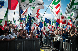 September 30, 2018 - Rome, Italy, Italy - Supporters of Italy's centre-left Democratic Party (PD) wave party flags and flags of the European Union as they gather for a rally on Piazza del Popolo in downtown Rome to protest the government policiesduring the Italy's centre-left Democratic Party (PD) leader Maurizio Martina delivers a speech during a rally of the PD on Piazza del Popolo in downtown Rome to protest the government policies,. on September,30 2018 in Rome, Italy. (Credit Image: © Andrea Ronchini/NurPhoto/ZUMA Press)