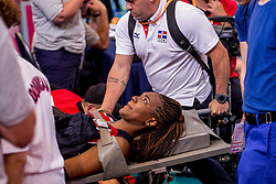 08-07-2017 NED: World Grand Prix Dominican Republic - Japan, Apeldoorn<br /> Fourth match of first weekend of group C during the World Grand Prix / Dominican Republic defeats Japan with 3-1 - Brayelin Elizabeth Martinez #20 leave the pitch on stretcher after she did not feel well