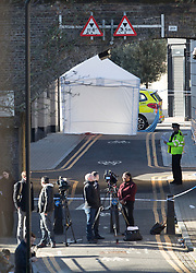 © Licensed to London News Pictures. 05/04/2018. London, UK. A police tent covers the murder scene in Hackney after a 20 year old man was stabbed in Link Street. Police were approached by a man suffering from stab injuries at 8pm last night he was pronounced dead at 8. 24pm by officers. Photo credit: Peter Macdiarmid/LNP