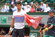 Novak Djokovic (SRB) feels the pressure during the third round of the Roland Garros Tennis Open 2017 at Roland Garros Stadium, Paris, France on 2 June 2017. Photo by Jon Bromley.