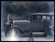 couple posing with dog by their car France ca 1930s