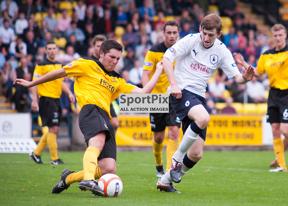 Livingston captain Liam Fox clears the danger as Blair Alston closes in, Livingston v Falkirk, SFL Division 1