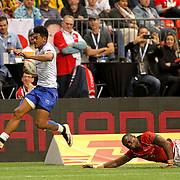 Joe Perez skips away from a Kenyan in scoring a second half try in Samoa's 26-7 trouncing of Kenya at Canada Sevens, Day 2, BC Place, Vancouver, Canada.  Photo by Barry Markowitz, 3/12/17