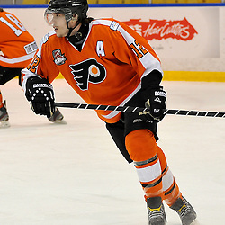WHITBY, ON - Feb 11: Ontario Junior Hockey League game between Orangeville Flyers and Whitby Fury. Peter Stepanis #12 of the Orangeville Flyers Hockey Club during first period game action.<br /> (Photo by Shawn Muir / OJHL Images)