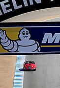 Image of a red Porsche Speedster competing at Rennsport Reunion V at Mazda Raceway Laguna Seca, Monterey, California, America west coast