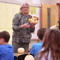 Adam Robison | BUY AT PHOTOS.DJOURNAL.COM<br /> Kathryn Gatlin, with the Tupelo Garden Club, goes over a Thanksgiving craft project to Jr. Garden Club members at Lawndale Elementary School to make centerpieces out of pumpkins and flowers Monday afternoon at LAwndale Elementary School in Tupelo.