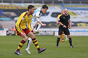 Huddersfield Town midfielder Joe Lolley (18) with a shot  during the Sky Bet Championship match between Huddersfield Town and Burnley at the John Smiths Stadium, Huddersfield, England on 12 March 2016. Photo by Simon Davies.