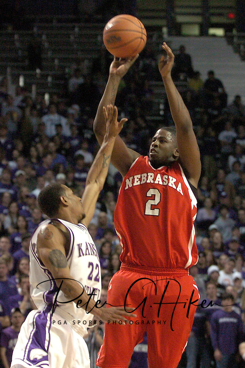 Nebraska guard Joe McCray (R) fires a shot over Kansas State's Mario Taybron (L) in the first half.  The Huskers defeated K-State 57-42 at Bramlage Coliseum in Manhattan, Kansas, January 11, 2006.