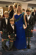 MRS. HOUSTON MORRIS with her children,  The Royal Caledonian Ball 2015. Grosvenor House. Park Lane, London. 1 May 2015.