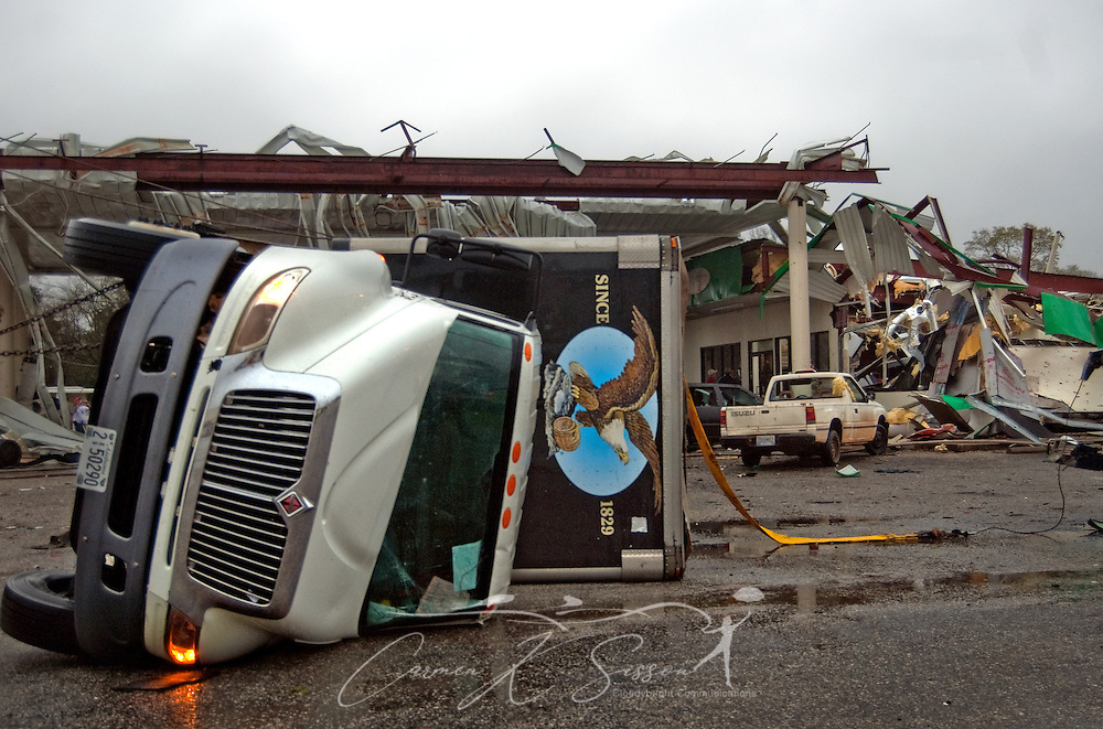 A semi truck lies on its side in front of a damaged BP gas station following a tornado in Theodore, Ala. March 9, 2011. Three people were injured, and 17,000 residents were left without power following the storm, which moved through the area around 9 a.m. (Photo by Carmen K. Sisson/Cloudybright)