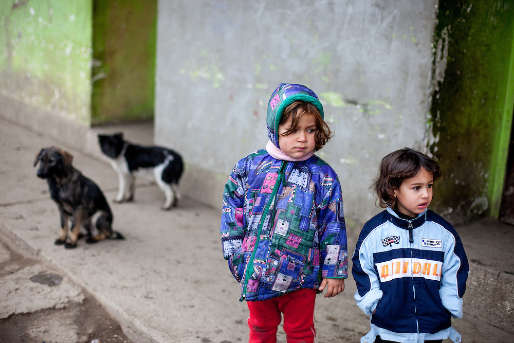 """Two girls on the street at the Roma settlement located in """"Budulovskej Street"""" in Moldava nad Bodvou, Eastern Slovakia about 30 km from Kosice."""