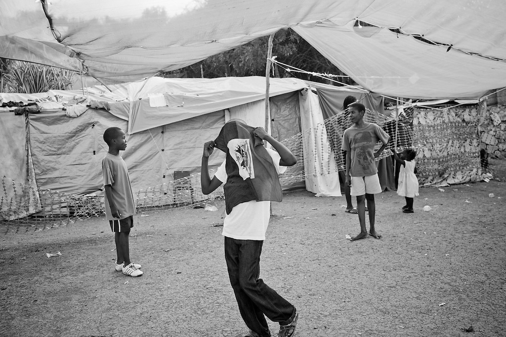 A boy holds a Haitian flag over his face in a camp for those displaced by the recent earthquake in Petionville, outside Port-au-Prince, Haiti.
