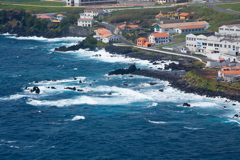 A view of the  south shore of Horta and Porto Pim.In the image we can see typical color scheme of houses..Horta is on the Portuguese island of Faial, one of the Azores, which mark the most western boundaries of the E.U.