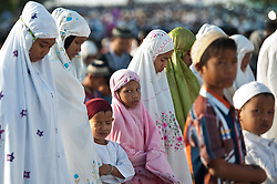 Image ©Licensed to i-Images Picture Agency. 28/07/2014. South Sumatera Province. Indonesia. <br /> 61981796<br /> Muslims gather on the main way in front of the Great Mosque Palembang to attend the Eid Al-Fitr celebration in Palembang, South Sumatera Province in Indonesia, on July 28, 2014. Eid Al-Fitr marks the end of the Muslim fasting month of Ramadan. Picture by  imago / i-Images<br /> UK ONLY
