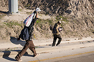 Tijuana, Mexico: Honduran refugees walk along the border with USA.