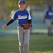 A young baseball player stands on second base during the Norwalk Little League baseball competition at Broad River Fields,  Norwalk, Connecticut. USA. Photo Tim Clayton