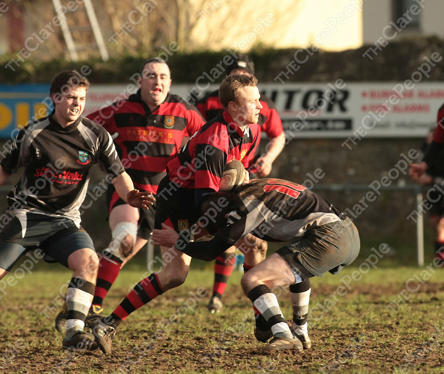 Ennis RFC Niall Nevin &amp; Scarriff RFC James Kelly in action during their Game played in Showgrounds Ennis Co.Clare..<br /> Picture Credit  Brian Gavin Press 22