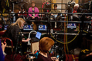 Television crews relax in the US Capitol Rotunda as the president is sworn-in outside during the presidential inauguration, January 21, 2013 in Washington, DC.