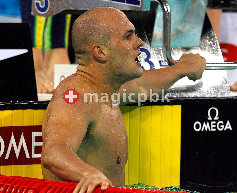 Australia's Ashley CALLUS relaxes after winning the gold medal in the men's 4 x 100m Medley Relay Final during day five of the 8th FINA World Swimming Championships (25m) held at Qi Zhong Stadium April 9, 2006 in Shanghai, China. (Photo by Patrick B. Kraemer / MAGICPBK)