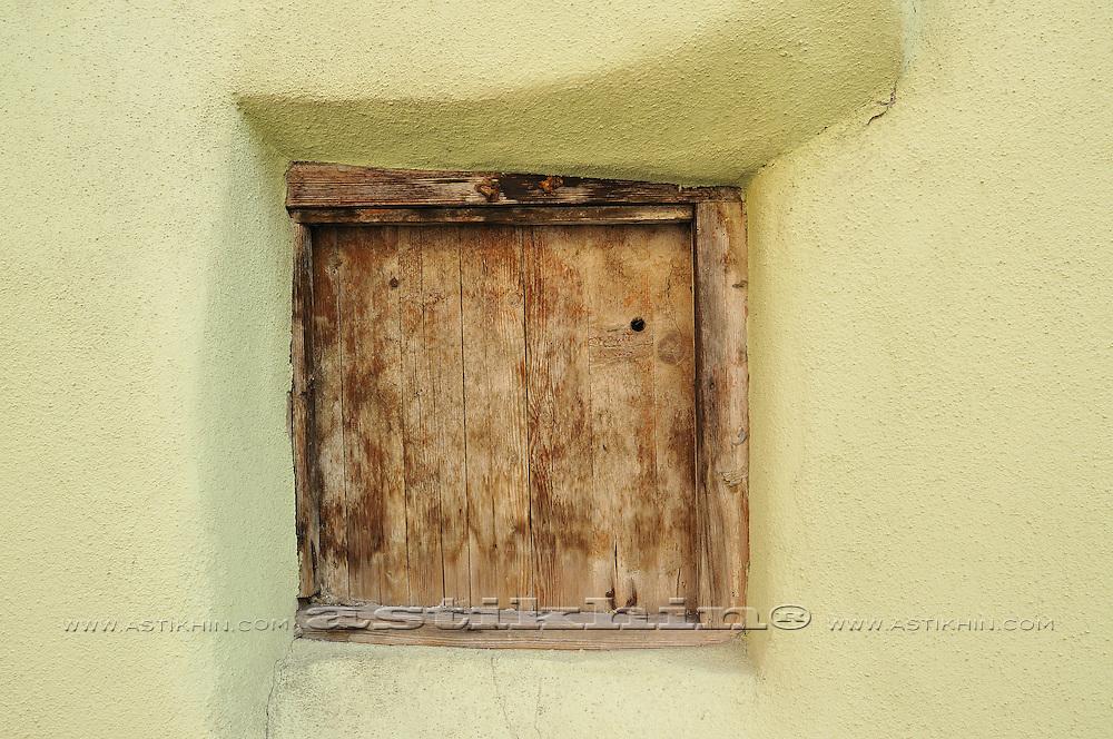 Window on 800 years old wall
