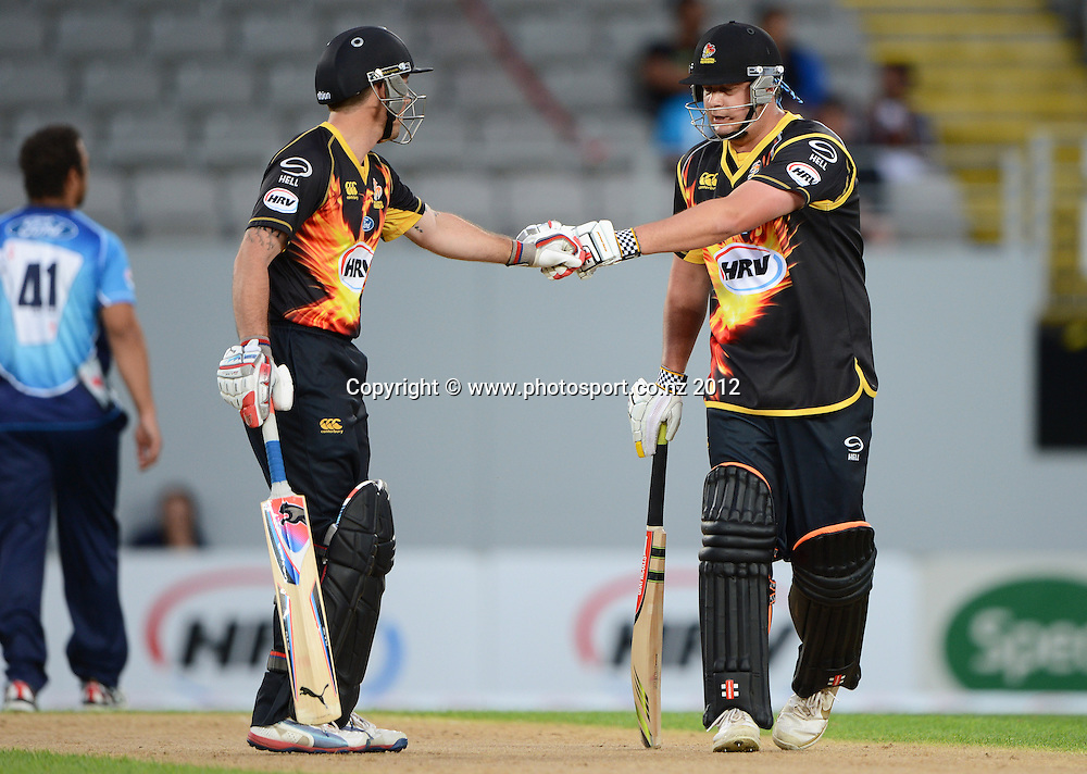 Wellington's Luke Ronchi and Jesse Ryder during the HRV Cup Twenty20 Cricket match between Auckland Aces and Wellington Firebirds at Eden Park on Friday 28 December 2012. Photo: Andrew Cornaga/Photosport.co.nz