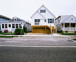 12 houses photographed on the island of Ocean City, NJ 08226 for a field survey of Post Sandy damage and recovery. Visually surreal, and unbelievable bohemoth houses, have been jacked up, and await for a new foundation installed. © 2013 Jackie Neale