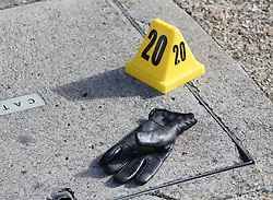 © Licensed to London News Pictures. 30/09/2017. London, UK. A police evidence marker sits next to a glove after a man was fatally stabbed in Bow, East London. Police were called at 2:30 am on Saturday, 30 September to reports of a disturbance in E3. Officers found a 21-year-old man suffering from stab injuries. He was treated at the scene by London's Air Ambulance before being taken to an east London hospital where he died. Detectives from the Homicide and Major Crime Command are investigating. Photo credit: Peter Macdiarmid/LNP