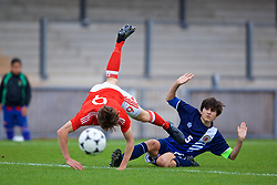 NEWPORT, WALES - Sunday, September 24, 2017: Wales' William Russ is tackled by Gibraltar's Niall Serra during an Under-16 International friendly match between Wales and Gibraltar at the Newport Stadium. (Pic by David Rawcliffe/Propaganda)