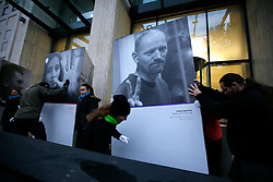 UK ENGLAND LONDON 21NOV13 - Greenpeace installs a photo exhibition outside the Shell Building in London called '30 Acts of Courage' The exhibition consists of photographic portraits of the Arctic 30 – the 28 Greenpeace activists and two journalists who are awaiting trial on piracy and hooliganism charges in Russia. Greenpeace is drawing attention to Shell and their Russian partner Gazprom's planned joint venture to drill for oil in the Arctic.<br /> <br /> jre/Photo by Jiri Rezac<br /> <br /> © Jiri Rezac 2013