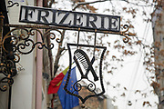 Frizerie - barbershop sign in Bucharest, Romania